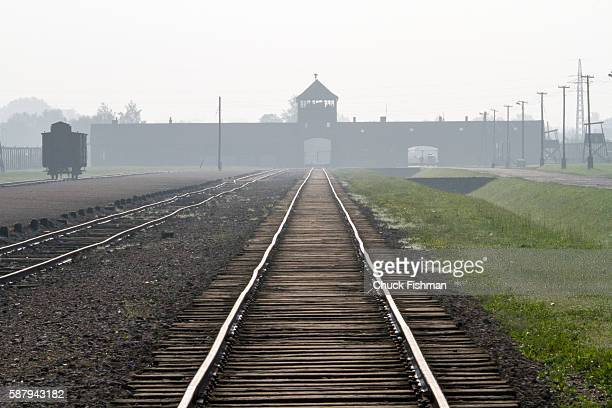 View of train tracks leading to the main gate of the former Auschwitz II–Birkenau concentration camp now the AuschwitzBirkenau State Museum Oswiecem...