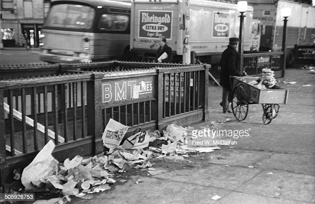 View of trash against a subway entrance on the sidewalk of E 14th Street New York New York January 8 1972