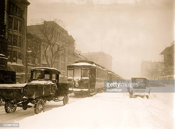 View of trolleys and vehicles stuck and lined up on the city streets during the Knickerbocker blizzard Washington DC 1922