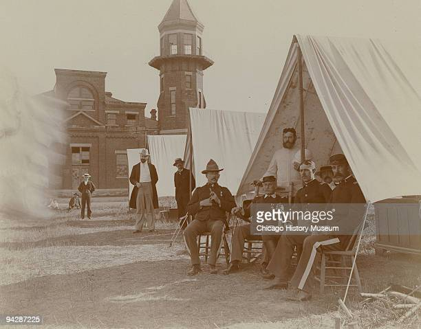 View of troops sitting outside their tents during the Pullman railroad Strike Chicago 1894