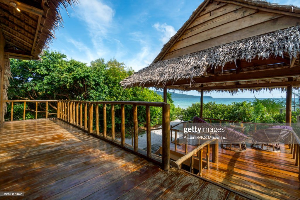 View of tropical resort in beach setting : Stock Photo