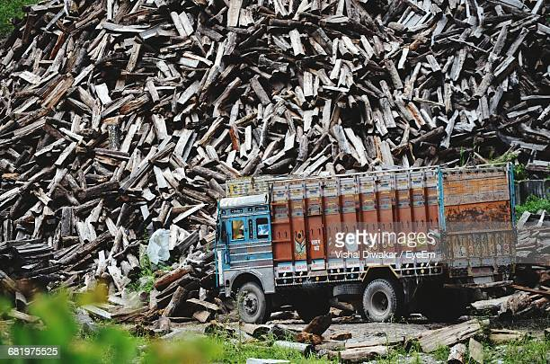 View Of Truck By Wood Pile