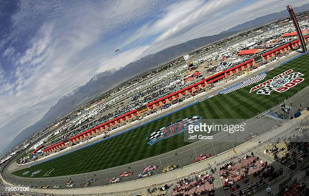 View of trucks racing during the NASCAR Craftsman Truck Series San Bernardino County 200 at the Auto Club Speedway on February 23, 2008 in Fontana,...
