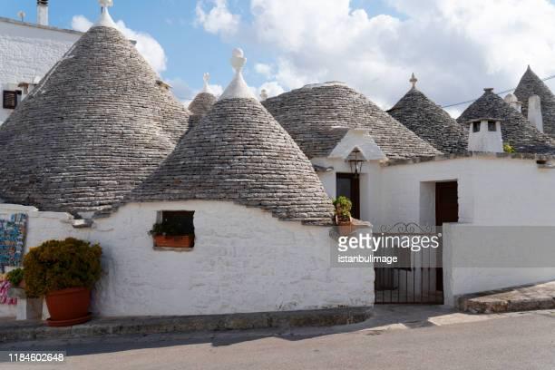 view of trulli houses in alberobello,italy. - alberobello foto e immagini stock