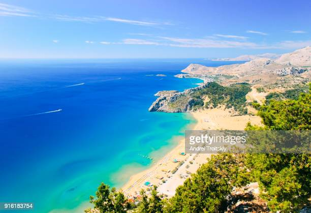 view of tsambika beach from the hill near tsambika church, rhodes, greece - rhodes dodecanese islands stock photos and pictures