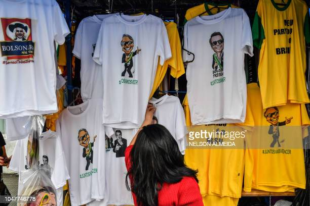 TOPSHOT View of Tshirts with images of presidential candidate for the Social Liberal Party Jair Bolsonaro displayed in a shop of a popular shopping...