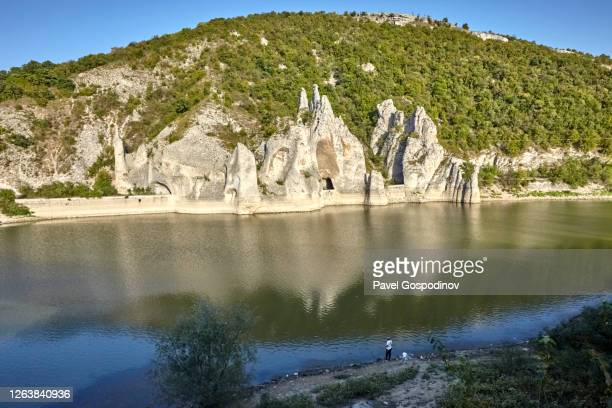 view of tsonevo dam and the rock phenomenon wonderful rocks, east bulgaria (chudnite skali) - light natural phenomenon stock pictures, royalty-free photos & images