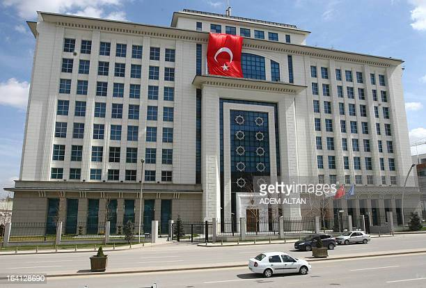 A view of Turkey's ruling Justice and Development Party headquarters taken on March 20 2013 in Ankara with a giant national flag covering the damages...