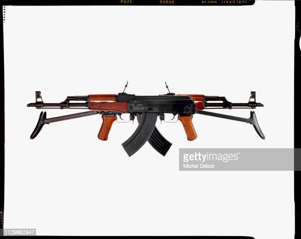 View of two AKM assault rifles both with an attached magazines seen against a white background New York New York March 9 1994 The photo was taken as...