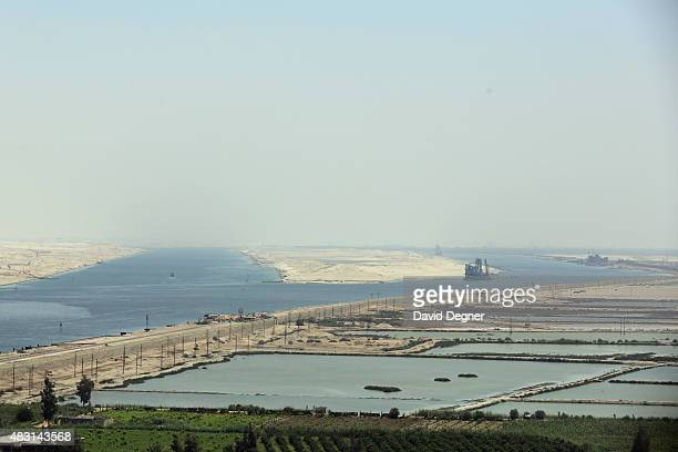 View of two channels of the Suez Canal during the opening ceremony of the new Suez Canal expansion including a new 35km channel on August 6, 2015 in...