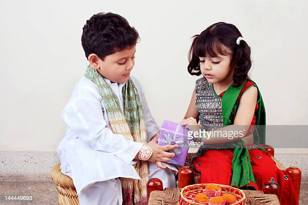 view of two children - raksha bandhan stock photos and pictures