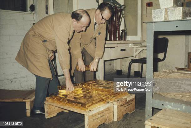 View of two employees preparing to weigh bars of gold ingots at the premises of Johnson Matthey bullion brokers and bankers in Hatton Garden, London...