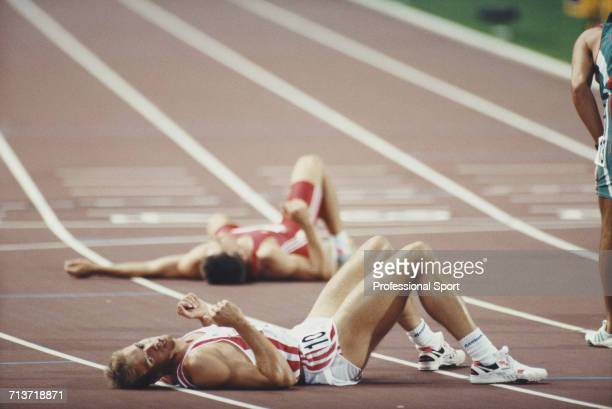 View of two exhausted athletes lying on the track including in foreground 6th placed Paul Meier of Germany after completing the 1500 metres final...