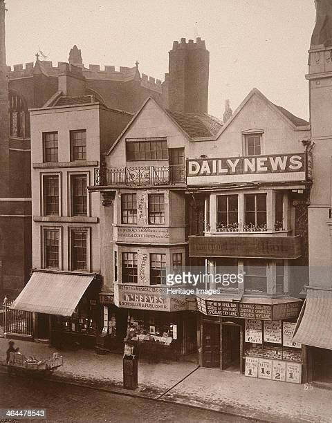 View of two figures standing near a shop front on Macclesfield Street Soho London 1883