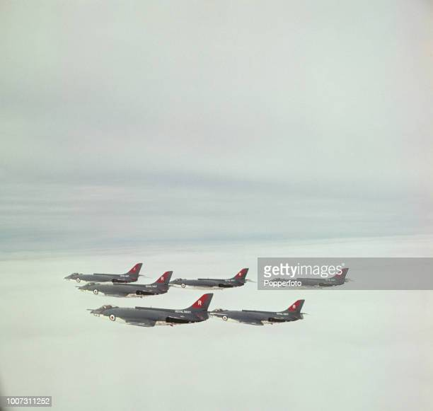 View of two flights of six Supermarine Scimitar fighter aircraft from 800 Naval Air Squadron of the Royal Navy Fleet Air Arm flying in formation...