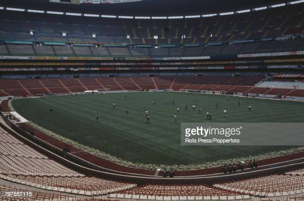 View of two football teams playing a match on the pitch inside the Estadio Azteca football stadium in Mexico City Mexico in May 1970 The stadium...