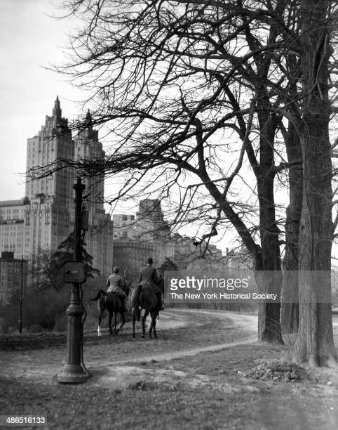 View of two horseback riders riding horses on the bridle path in Central Park New York 1930