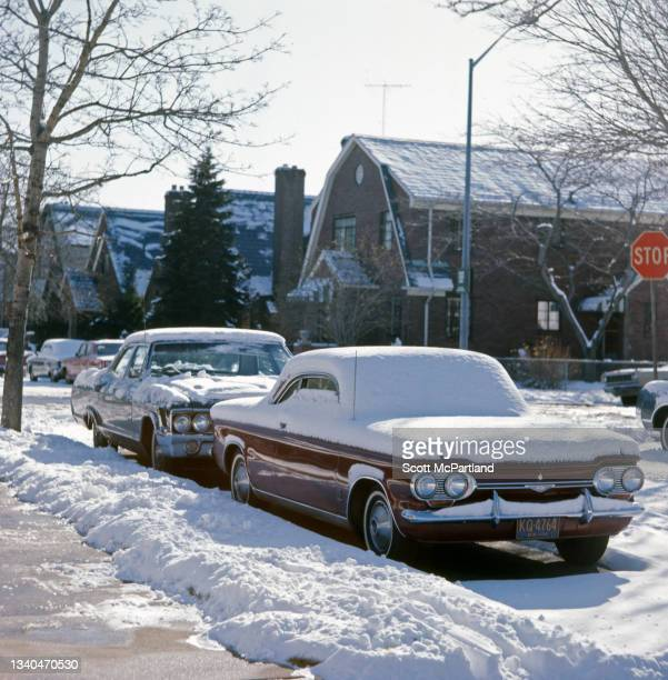 View of two snow-covered sedans on Fitchett Street , in the Rego Park neighborhood of Queens, New York, New York, February 11, 1967.