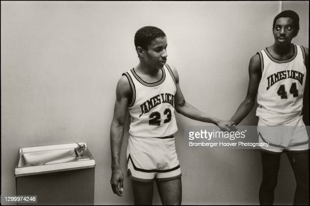 View of two, unidentified James Logan High School basketball players as they console one other after a loss, Hayward, California, 1985.
