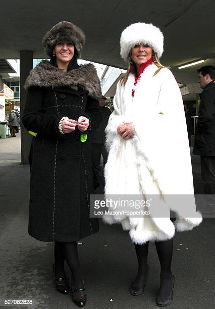 View of two women wearing fur style hats and coats on Ladies Day during the 2009 Cheltenham National Hunt Festival at Cheltenham racecourse in...