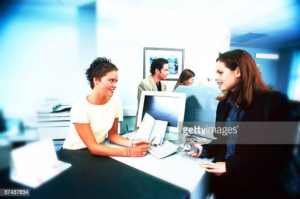 view of two young women at a desk