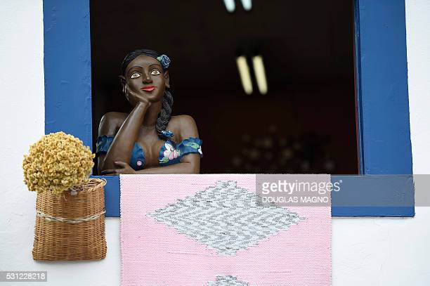 View of typical handmade doll on a window during the arrival of the Olympic Torch to Ouro Preto historic city in Minas Gerais Brazil on May 13 2016 /...