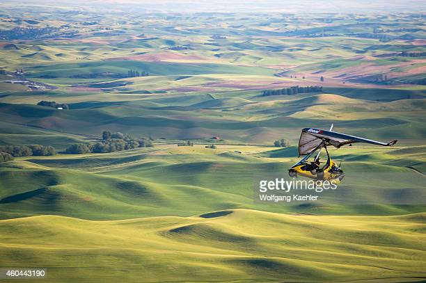 View of ultralight plane and fields from Steptoe Butte State Park in Whitman County in the Palouse near Pullman Washington State USA