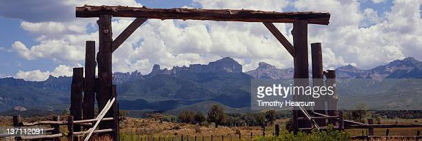 view of uncompahgre plateau through large gate - timothy hearsum stock pictures, royalty-free photos & images