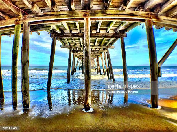 view of underneath pier at beach - kitty hawk beach stock pictures, royalty-free photos & images