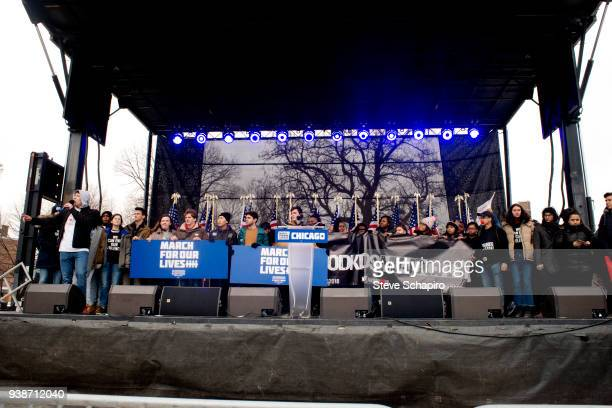 View of unidentified advocates against gun violence on stage during the March For Our Lives rally, Chicago, Illinois, March 24, 2018. Several hold...