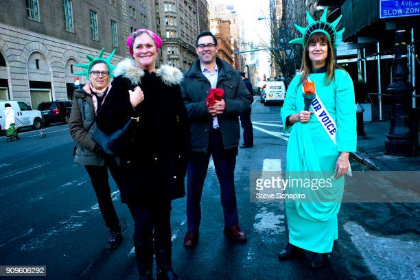 View of unidentified demonstrators at the Women's March on New York New York January 20 2018 One woman is dressed as the Statue of Liberty while...