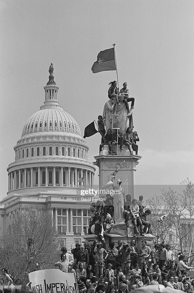 View of unidentified demonstrators on and around the Peace Monument (also known as the Naval Monument and the Civil War Sailors Monument) during a massive rally demonstration in opposition to the war in Vietnam and the continued US military presence there, Washington DC, April 14, 1971. The US Capitol Building is visible in the background.