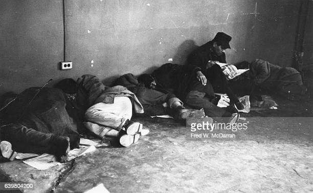 View of unidentified men as they sleep against a wall on the floor in the Municipal Lodging House New York New York February 24 1967
