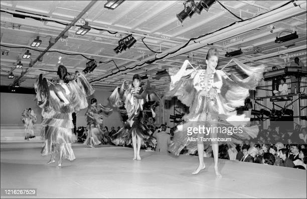 View of unidentified models on the catwalk during Issey Miyake's Spring fashion collection show, held at the Intrepid Sea, Air, and Space Museum, New...