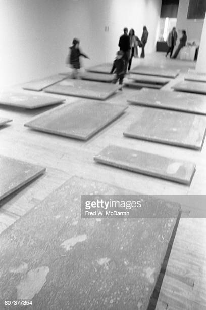 View of unidentified works of art on the floor of a gallery New York New York January 23 1971 Among the visible people are the photographer's sons...