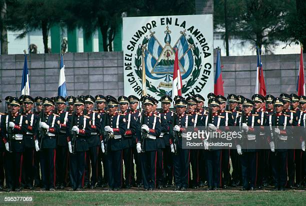 View of uniformed Salvadoran military academy cadets as they stand at attention on a field, San Salvador, El Salvador, May 1, 1983.