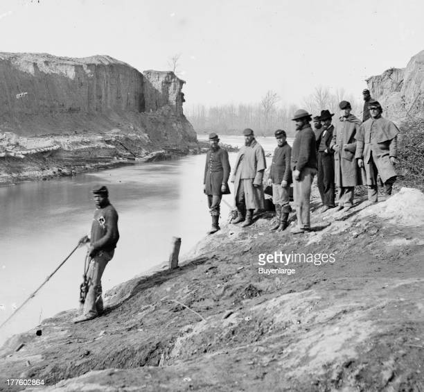 View of Union troops trying to build a canal at Dutch Gap, 1865. Among their workers were paid African-American laborers from the Roanoke Island...