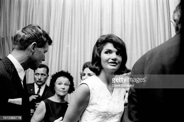 View of United States Attorney General Robert F Kennedy and his sisterinlaw former US First Lady Jacqueline Kennedy as they attend a reception on the...