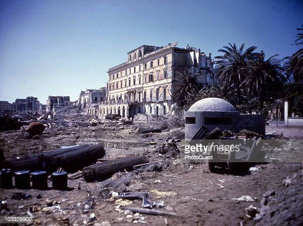 View of unloaded supplies and combat debris on the beach during Operation Shingle Anzio Italy April 15 1944 A reinforced concrete pillbox is visibl...