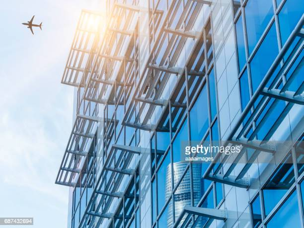 view of urban architecture with a plane flying over