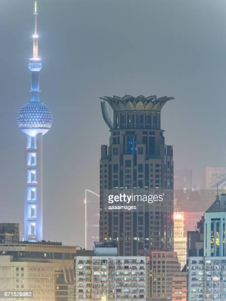 view of urban architecture,detail shot of Shanghai landmarks at night