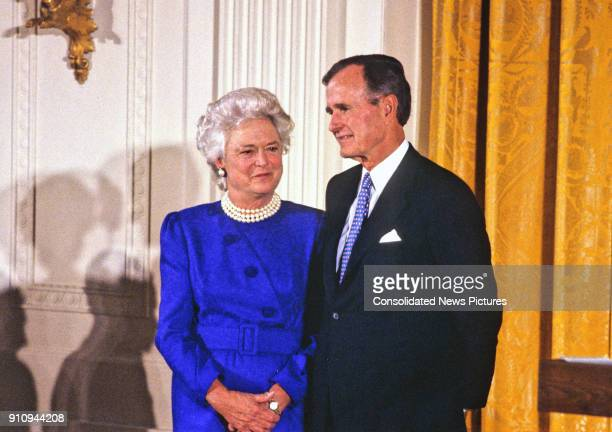 View of US First Lady Barbara Bush and President George HW Bush during the National Medal of Arts ceremony in the White House's East Room Washington...