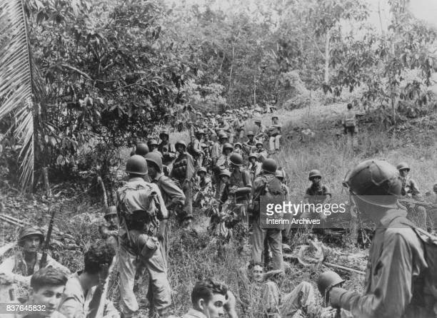 View of US Marines in a column as they rest on their way to higher ground during the Battle of Guadalcanal, Guadalcanal, Solomon Islands, 1943 or...
