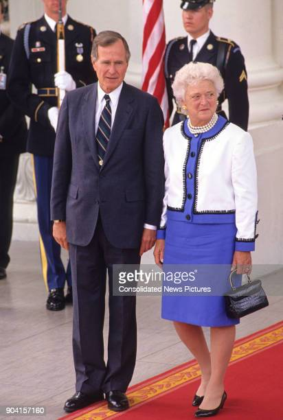 View of US President George HW Bush and First Lady Barbara Bush at the White House's North Portico Washington DC June 3 1990 They were bidding...