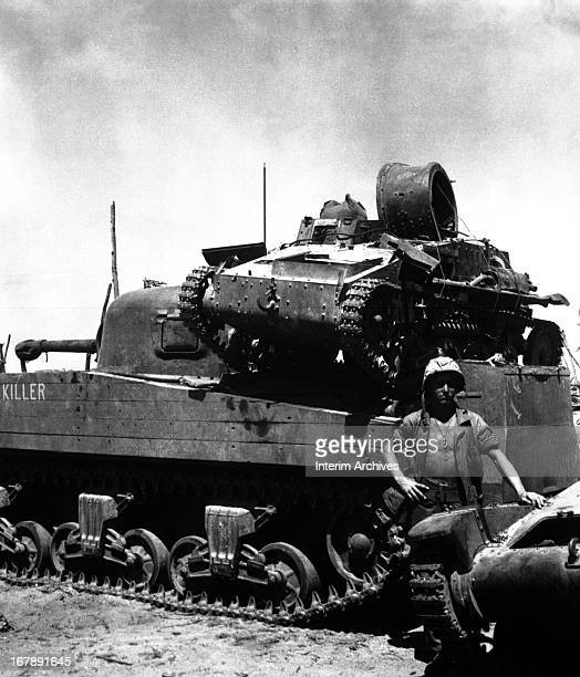 View of US soldier as he poses beside a tank Kwajalein Atoll Marshall Islands 1940s