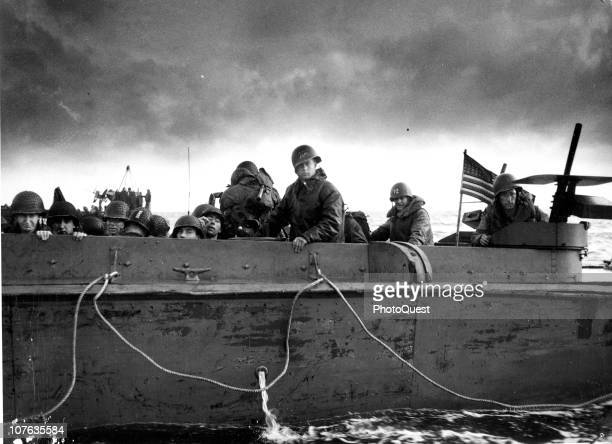 View of US soldiers on a Coast Guard vessel as it crosses the English Channel to deliver reinforcements to the French coast during D-Day operations,...