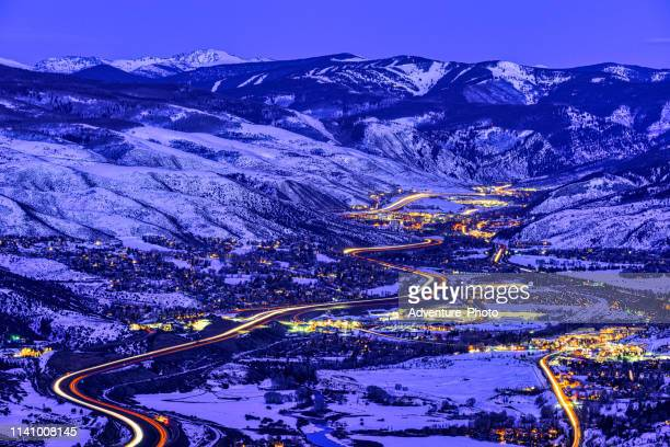 view of vail valley at sunset and dusk - interstate 70 stock photos and pictures