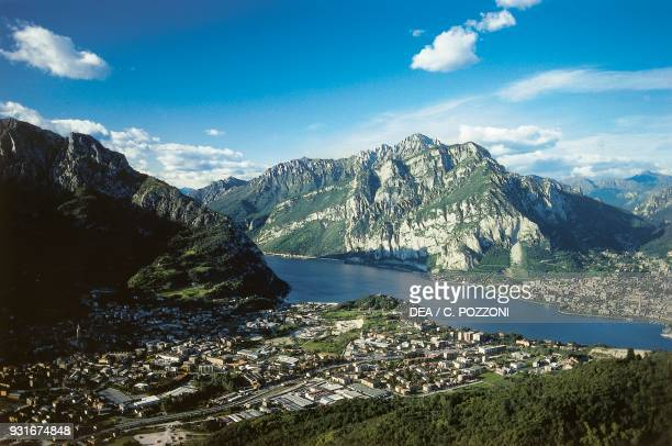 View of Valmadrera, Lecco and Lake Como, with the Grigne mountain group in the background, Lombardy, Italy.