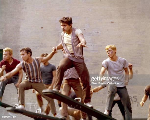 View of various cast members on seesaws in a schoolyard set in a scene from 'West Side Story' 1961
