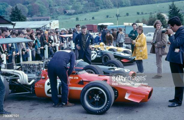 View of various Formula 5000 cars and drivers lined up in the paddock prior to competing in the Kent Messenger 5000 race round 3 of the 1969 Guards...